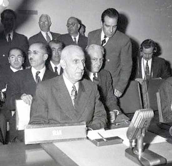 Dr Mosaddegh and Dr Fatemi (standing) during a speech at the United Nations