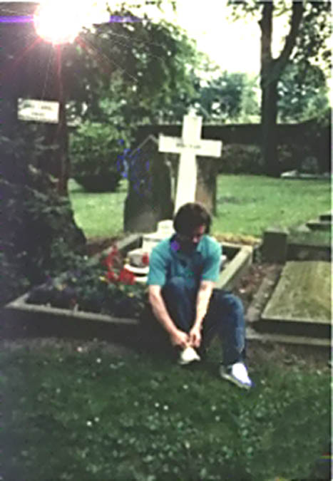 Poet tying his shoes at C S Lewis' grave